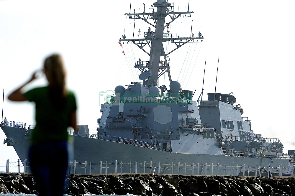 April 6, 2017 - *FILE PHOTO* - President Trump ordered a massive military strike on a Syrian air base in retaliation for a 'barbaric' chemical attack he blamed on Syria's President. Navy gun ships USS Porter and USS Ross targeted Shayrat Airfield in Syria, where planes that carried out the chemical attack where launched from. Pictured: Apr. 25, 2011 - Ft. Lauderdale, FL - Florida, USA - A woman takes pictures of the USS ROSS missile destroyer as it enters Port Everglades on Monday. (Credit Image: © Sun-Sentinel/ZUMAPRESS.com)