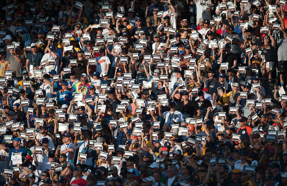 Fans participate during a Stand Up 2 Cancer moment during the 2016 MLB All-Star Game at Petco Park in San Diego on Tuesday.<br /> <br /> ///ADDITIONAL INFO:   <br /> <br /> allstar.0713.kjs  ---  Photo by KEVIN SULLIVAN / Orange County Register  -- 7/12/16<br /> <br /> The 2016 MLB All-Star Game at Petco Park in San Diego.