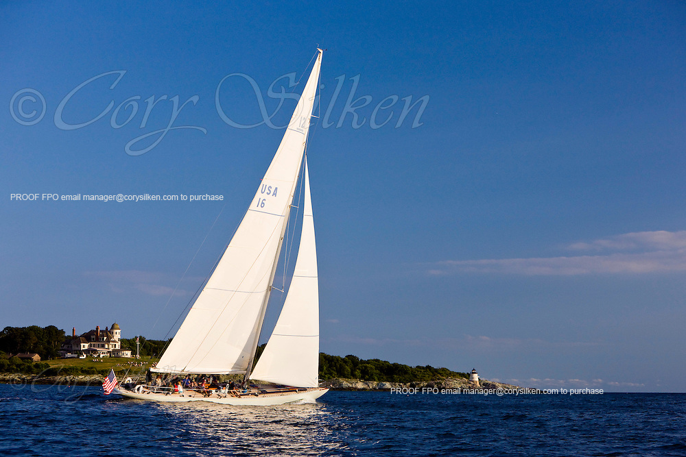 Columbia, 12 Meter Class, crusing by Castle Hill during a sunset sail.