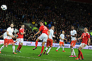 Emyr Huws of Wales © heads and scores his teams 2nd goal to make it 2-2. Vauxhall International football friendly, Wales v The Netherlands at the Cardiff city stadium in Cardiff, South Wales on Friday 13th November 2015. pic by Andrew Orchard, Andrew Orchard sports photography.