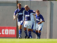 Fotball<br /> Foto: SBI/Digitalsport<br /> NORWAY ONLY<br /> <br /> Coca Cola League Two <br /> Leyton Orient V Macclesfield Town 07/08/2004<br /> <br /> Macclesfield Town's Matthew Tipton (middle) celebrates his first half goal with team mates