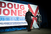 """BIRMINGHAM, AL – DECEMBER 11, 2017: On the eve of the Special General Election for Senate, basketball star Charles Barkley hands greets Birmingham Mayor Randall Woodfin before he speaks to the crowd and endorses democratic candidate Doug Jones in a """"get out the vote"""" rally.  CREDIT: Bob Miller for The New York Times"""
