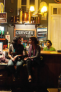 Barranco, nightlife. Two girls at the bar of Sargento Pimienta, famous concert hall