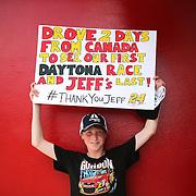 A NASCAR fans holds up a Jeff Gordon sign during the 57th Annual NASCAR Coke Zero 400 race first practice session at Daytona International Speedway on Friday, July 3, 2015 in Daytona Beach, Florida.  (AP Photo/Alex Menendez)
