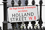 Residential street sign for Holland Street in Kensington. In a selected few boroughs of West London, wealth has changed over the last couple of decades. Traditionally wealthy parts of town, have developed into new affluent playgrounds of the super rich. With influxes of foreign money in particular from the Middle-East. The UK capital is home to more multimillionaires than any other city in the world according to recent figures. Boasting a staggering 4,224 'ultra-high net worth' residents - people with a net worth of more than $30million, or £19.2million.. London, England, UK.