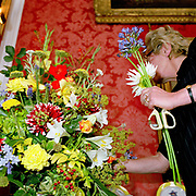 Flower arranger, Joyce Farrow arranges freshly picked flowers from the garden at Castle Howard stately home, North Yorkshire, UK. Castle Howard is located in the Howardian Hills AONB, a landscape with well-wooded rolling countryside, patchwork of arable and pasture fields, scenic villages and historic country houses with classic parkland landscapes.