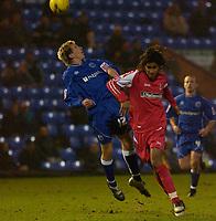 Photo: Daniel Hambury.<br />Peterborough United v Swindon Town. LDV Vans Trophy. 22/11/2005.<br />Swindon's Ashan Holgate and Peterborough's Sean St. Ledger battle for the ball.