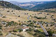 Road running through landscape in Sierra de Grazalema natural park, Cadiz province, Spain