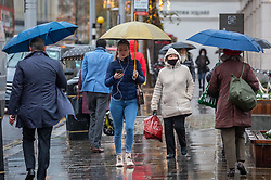 © Licensed to London News Pictures. 03/12/2020. London, UK. Christmas shoppers brave the cold, rain and sleet in Chelsea, London on the 2nd day of the new Tier 2 restrictions for London, where non-essential shops can now open. Today weather experts predict a cold weekend ahead with a high of 6c with snow showers and heavy rain forecast. Jonathan Van-Tam has warned that face coverings and restrictions could be necessary for months or years to come despite the rolling out of the new Pfizer/BioNTech's coronavirus vaccine which is expected to arrive in the UK today. Also in the news, more woes for high street workers as 20,000 jobs are at risks after the collapse of Topshop and Debenhams stores this week. Photo credit: Alex Lentati/LNP