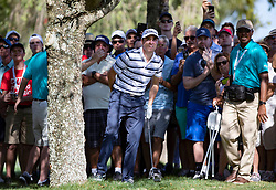February 28, 2019 - Palm Beach Gardens, Florida, U.S. - Justin Thomas watches his second shot on the 10th hole during the first round of the Honda Classic Thursday. Thomas hit his nine iron on the tree slightly bending the club at PGA National Resort and Spa in Palm Beach Gardens, February 28, 2019. (Credit Image: © Allen Eyestone/The Palm Beach Post via ZUMA Wire)