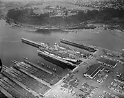 Y-560824-17. Dry-docks at Swan Island, University of Portland Campus is shown in the background. August 24, 1956