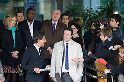 © Licensed to London News Pictures. 29/11/2012. London, UK. Kate McCann (left, turquoise scarf), the mother of Madeleine McCann, and Brian Dowler (centre purple tie), the father of Millie Dowler, are seen outside the Queen Elizabeth Conference Centre in London today (29/11/12) with other members of the 'Hacked Off' campaign group after hearing the results of Lord Leveson's inquiry into the British media. Photo credit: Matt Cetti-Roberts/LNP