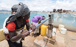 30 May 2019, Mokolo, Cameroon: A woman pumps water at one of the boreholes through which the Lutheran World Federation's World Service programme supplies drinking water to refugees in Minawao. The Minawao camp for Nigerian refugees, located in the Far North region of Cameroon, hosts some 58,000 refugees from North East Nigeria. The refugees are supported by the Lutheran World Federation, together with a range of partners.