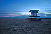 Lifeguard Tower 18 on the Beach at sunset in Huntington Beach California