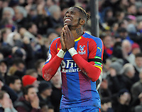 Football - 2018 / 2019 Premier League - Crystal Palace vs. West Ham United<br /> <br /> Wilfried Zaha of Palace shows his anguish after missing a late chance to win the match, at Selhurst Park.<br /> <br /> COLORSPORT/ANDREW COWIE