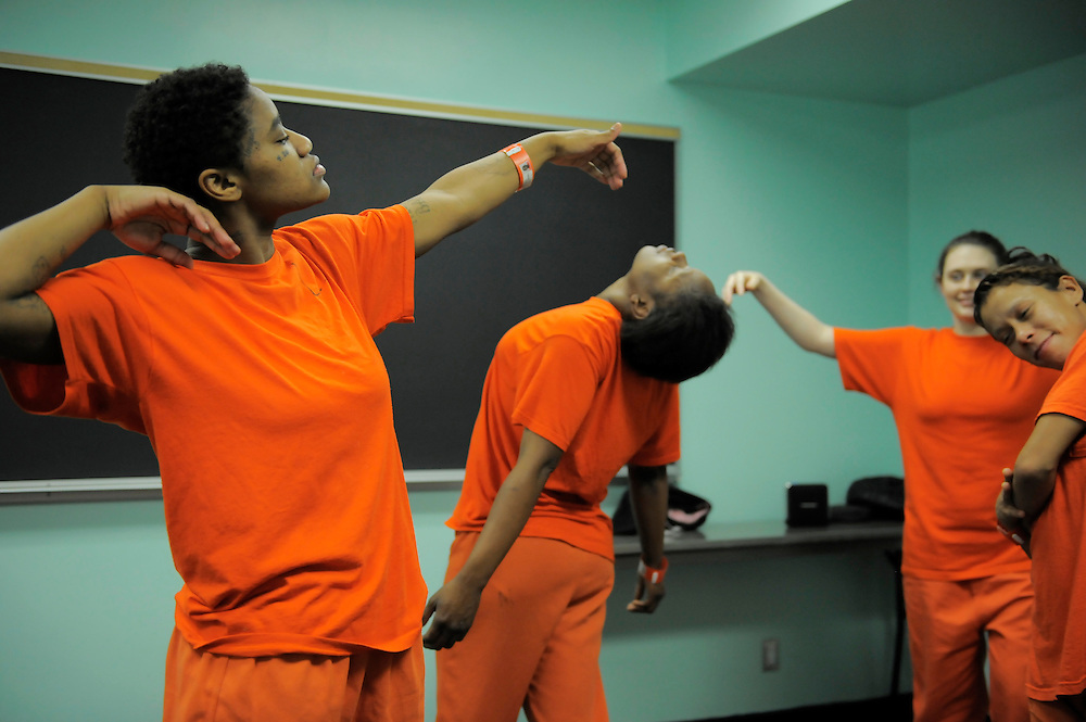 """From left, inmates Demetrius Carroll, Erica Jones, Tasha Anderson and Marisabela Sarria dance during a """"ecstatic"""" dance class by teacher Sylvie Minot at the San Francisco County Jail on July 17, 2014 in San Francisco, CA. Sylvie Minot leads dance classes inside the SF County Jail to help bring inmates inner peace. Minot also leads classes for the public in Marin, and for vets at the VA clinic."""