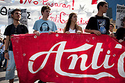 Students demonstrate against austerity measures and planned education reforms in Athens. The demonstration is against an education reform bill which aims to improve the operation of universities. These young students hold a red and white banner promoting anti capitalism