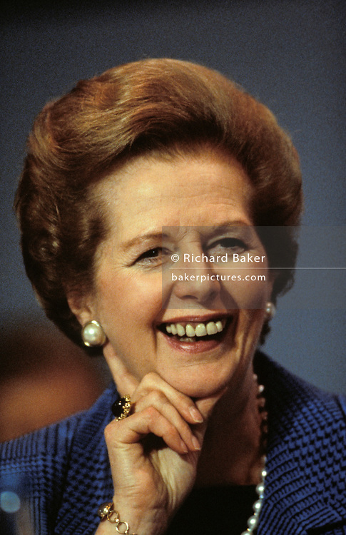 Margaret Thatcher listens to speeches, the last as Prime Minister during the October 1990 Conservative Party Conference in Blackpool, on 11th October 1990, in Blackpool, England. Weeks before being removed by her own colleagues, her fighting spirit and stern expression gives her the reputation of the Iron Lady.