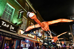 """© Licensed to London News Pictures. 18/01/2018. LONDON, UK.  """"Flamingo Flyway"""" by Lantern Company with Jo Pocock takes place in Chinatown.  Opening night of Lumiere London, the capital's largest arts festival commissioned by The Mayor of London and produced by Artichoke.  Light installations by leading artists have been set up, both north and south of the river for the public to view 18-21 January. Photo credit: Stephen Chung/LNP"""