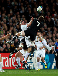 © Andrew Fosker / Seconds Left Images 2011 - France's Imanol Harinordoquy cries out as he apears to get a knee where it hurts from New Zealand's Richie McCaw (Captain) as they challenge for a high ball -  France v New Zealand - Rugby World Cup 2011 - Final - Eden Park - Auckland - New Zealand - 23/10/2011 -  All rights reserved..