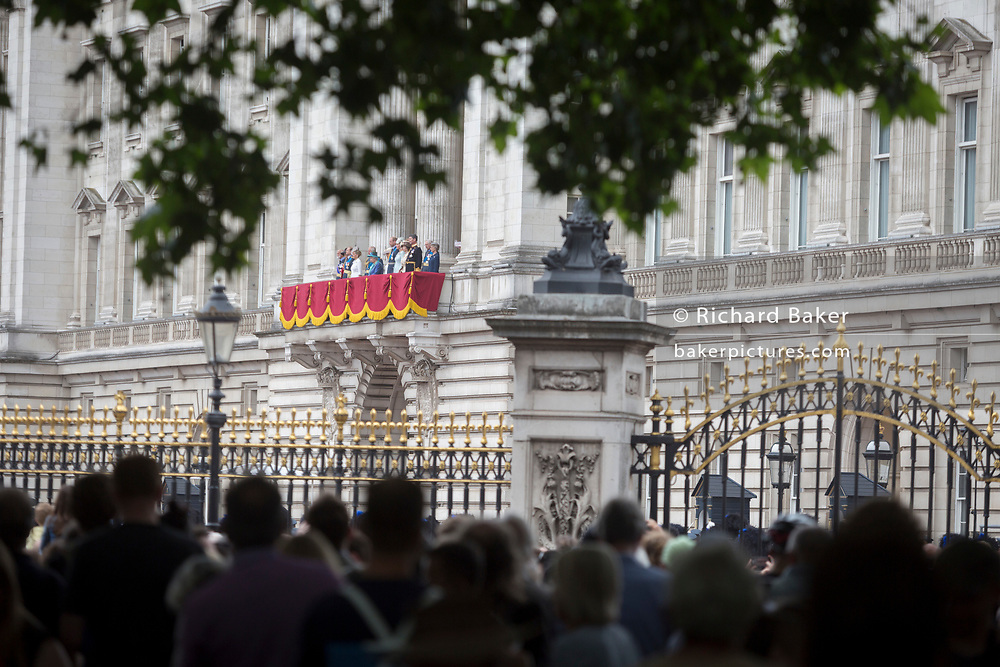 On the 100th anniversary of the Royal Air Force (RAF) and following a flypast of 100 aircraft formations representing Britain's air defence history which flew over central London, the Queen and other members of the royal family watch from the balcony of Buckingham Palace, on 10th July 2018, in London, England.