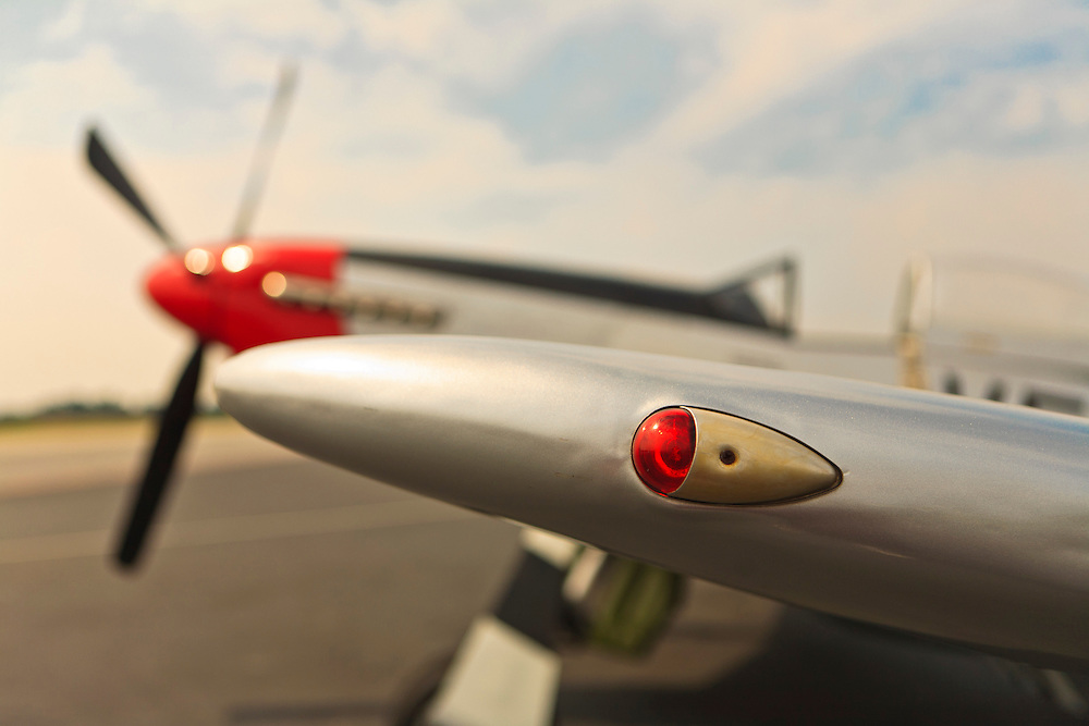 Left wing tip light of a restored P-51D Mustang, owned and operated by the Dixie Wing of the Commemorative Air Force.