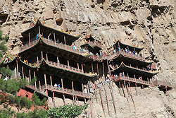 September 20, 2016 - Datong, Datong, China - Datong, CHINA-September 20 2016:?(EDITORIAL?USE?ONLY.?CHINA?OUT) ..The Hanging Temple, is a temple built into a cliff near Mount Heng in Hunyuan County, Datong City, north China¬°¬Øs Shanxi Province. The Hanging Temple is one of the main tourist attractions and historical sites in the Datong area. Built more than 1,500 years ago, this temple is notable not only for its location on a sheer precipice but also because it is the only existing temple with the combination of three Chinese traditional religions: Buddhism, Taoism, and Confucianism. The structure is kept in place with oak crossbeams fitted into holes chiseled into the cliffs. The main supportive structure is hidden inside the bedrock. The monastery is located in the small canyon basin, and the body of the building hangs from the middle of the cliff under the prominent summit, protecting the temple from rain erosion and sunlight. Coupled with the repair of the dynasties, the color tattoo in the temple is relatively well preserved. On December 2010, it was listed in the Time magazine as the world's top ten most odd dangerous buildings. (Credit Image: © SIPA Asia via ZUMA Wire)