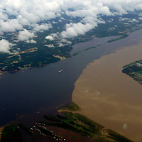 South America, Brazil, Amazonas. The meeting of the waters, where the Amazon River meets the Rio Negro.