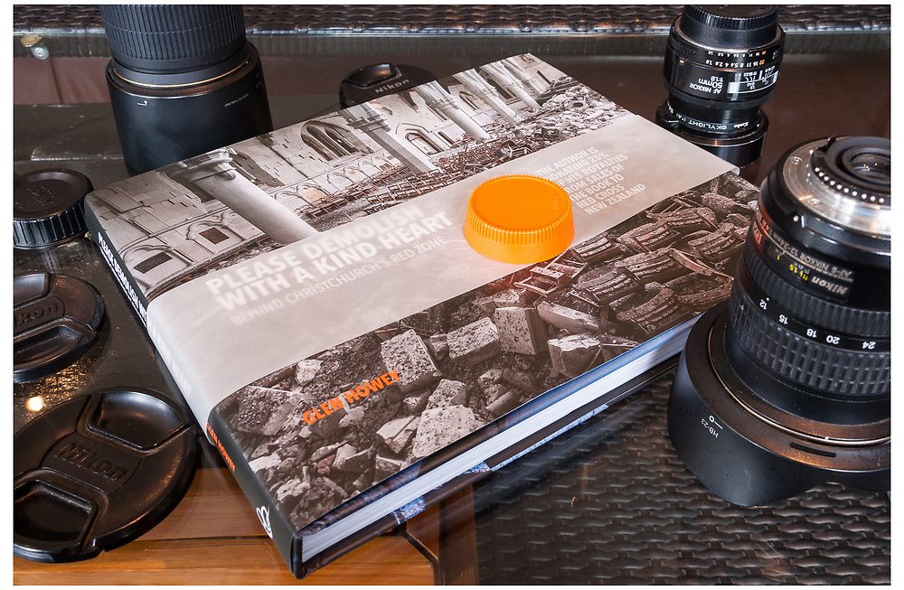 In 2015, I documented the ruins of the 2010 and 2011 Christchurch earthquakes in a book I called, Please Demolish With A Kind Heart - Behind Christchurch's Red Zone. The book received the Photographic Book Of The Year in 2017 from the New Zealand Institute of Professional Photography.<br /> <br /> The Christchurch earthquake of 22 February 2011 caused widespread devastation, resulting in the deaths of 185 people, injuring thousands and leaving a city traumatised.<br /> <br /> Years on, much of Christchurch has been transformed. Thousands of irreparably damaged suburban homes and central city buildings have been demolished and the rebuild is underway. But there are other places in the city – in red-zoned suburban streets and downtown blocks – that seem to be frozen in time.<br /> <br /> Officially deemed too dangerous to occupy, many are in a kind of suspended animation – the people are gone but everything they left as they fled remains there, in the same place, moved only by the thousands of aftershocks.<br /> <br /> Intrigued by these abandoned spaces, I noticed that they weren't being recorded, and believing it was important that they were, so I set out to do just that. The result is Please Demolish with a Kind Heart – a moving and at times eerie homage to Christchurch's abandoned homes, buildings, recreational spaces and iconic cathedrals; confronting reminders of how in seconds, people's lives were changed forever.<br /> <br /> Featuring over 200 images, Please Demolish with a Kind Heart is a poignant and important record of one of New Zealand's worst natural disasters, and a timely tribute to the indomitable spirit that is rebuilding Christchurch for future generations.
