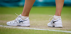 28.06.2014, All England Lawn Tennis Club, London, ENG, WTA Tour, Wimbledon, im Bild The Nike Zoom tennis shoes of Maria Sharapova (RUS) during her Ladies' Singles 3rd Round match on day six // 15065000 during the Wimbledon Championships at the All England Lawn Tennis Club in London, Great Britain on 2014/06/28. EXPA Pictures © 2014, PhotoCredit: EXPA/ Propagandaphoto/ David Rawcliffe<br /> <br /> *****ATTENTION - OUT of ENG, GBR*****