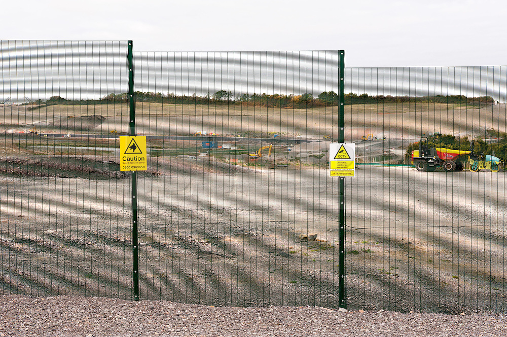 "© Licensed to London News Pictures. 19/10/2015. Hinkley Point, Somerset, UK.  View of preparations at the site of the proposed new nuclear power station Hinkley C, next to the existing Hinkley Point nuclear site. Anti-nuclear protest by the ""Osborne's Folly"" (after the Chancellor George Osborne) group, protesting against the proposed new nuclear power station Hinkley C and against Chinese investment in the project.  The group has occupied a roundabout near the site and erected an inflatable white elephant with a banner written in Chinese and say they want to send a message to the visiting Chinese President Xi Jinping that EDF's Hinkley C would be ""a bad investment"" for the Chinese state. They say that the stalled project has become ""Osborne's Energy Folly"" and should now be abandoned.  Theo Simon, one of the campaigners said: """"Ironically, the Chinese are leading the world in renewable energy investment in their own country, where there is also a growing anti-nuclear movement"". Photo credit : Simon Chapman/LNP"