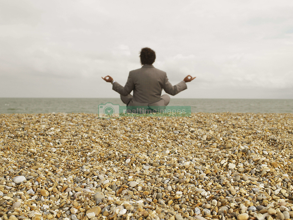Jun. 19, 2007 - Businessman in Yoga Position on Beach.. Model Released (MR) (Credit Image: © Cultura/ZUMAPRESS.com)