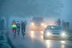 © Licensed to London News Pictures. 27/11/2020. London, UK. Walkers, cyclists drivers and Black Friday shoppers were hit with dense fog and a heavy frost this morning as they did the daily commute through Richmond Park, South West London. Yesterday Health Secretary Matt Hancock set out his plans for the end of lockdown on the 2 of December and introduced a new Covid Tier 2 restriction system for London with shops, pubs and restaurants to open up again for the Christmas period. Photo credit: Alex Lentati/LNP