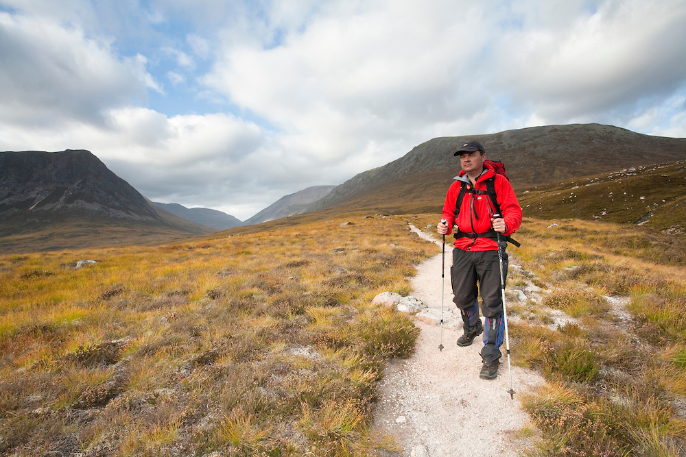 Lone walker in Glen Dee with Ben MacDui in the background, Scottish Highlands, Uk