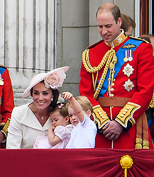 © Licensed to London News Pictures. 11/06/2016. London, UK. CATHERINE, DUCHESS OF CAMBRIDGE, PRINCESS CHARLOTTE, PRINCE GEORGE and PRINCE WILLIAM on the balcony of Buckingham Palace, during the Trooping The Colour ceremony in London. This years event is part of a weekend of celebration to mark the 90th birthday of Queen Elizabeth II, who is Britain's longest reigning monarch. Photo credit: Ben Cawthra/LNP