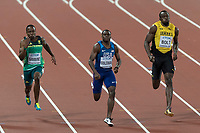 Athletics - 2017 IAAF London World Athletics Championships - Day Two, Evening Session<br /> <br /> Mens 100m Final <br /> <br /> Usain Bolt (Jamaica) puffs his cheeks as he tries to keep pace with Chris Coleman (United States) at the line at the London Stadium<br /> <br /> COLORSPORT/DANIEL BEARHAM