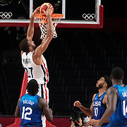 TOKYO, JAPAN - JULY 25:  Rudy Gobert. #27 of France slam dunks on the USA basketball team during the USA V France basketball preliminary round match at the Saitama Super Arena at the Tokyo 2020 Summer Olympic Games on July 25, 2021 in Tokyo, Japan. (Photo by Tim Clayton/Corbis via Getty Images)
