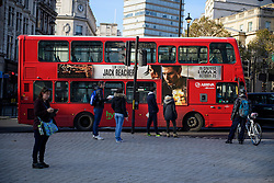© Licensed to London News Pictures. 11/11/2016. London, UK. A bus stood still to mark a minutes silence during Silence in the Square, a service held in Trafalgar Square, London to mark Remembrance Day. A minutes silence is held on the 11th hour of the 11th day of the 11th month, to recall the end of hostilities of World War I.  Photo credit: Ben Cawthra/LNP
