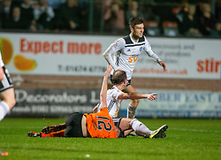 Dundee United's Sam Stanton brought down by Ayr United's player manager Mark Kerr for their penalty. Dundee United 4 v 0 Ayr United, Scottish Championship game played 21/12/2019 at Dundee United's stadium Tannadice Park.