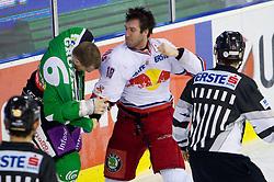 Daniel Bois of Salzburg and Bostjan Groznik of Olimpija in fight during ice-hockey match between HDD Tilia Olimpija Ljubljana (SLO) and EC Red Bull Salzburg (AUT) in 2nd Quaterfinals of EBEL league, on March 1, 2011 in Hala Tivoli, Ljubljana, Slovenia. (Photo By Vid Ponikvar / Sportida.com)