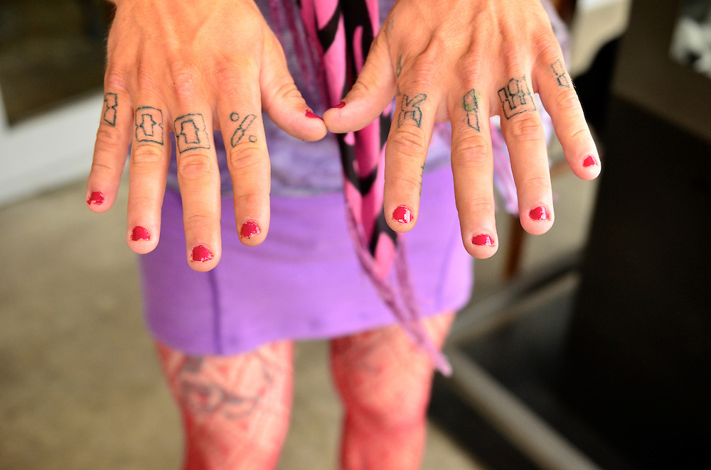Picton, New Zealand. Few hours before the 2012 New Years Eve. I stumbled into this proud kiwi transvestite  and friend and couldn't resist asking for a shot of his tatoos.