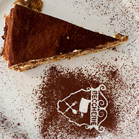"""TREVISO, ITALY - AUGUST 24:  A slice of Tiramisu is seen at the Restaurant """"Alle Beccherie on August 24, 2013 in Treviso, Italy. Treviso claims that Tiramisu was invented in the 1970s by Ada Campoel, the owner of the Restaurant called ÒAlle BeccherieÓ, who supposedly wanted to create a dessert that would give her an energy boost after the birth of her son.  (Photo by Marco Secchi/Getty Images)"""