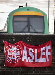 © Licensed to London News Pictures. 14/12/2016. London, UK. An ASLEF union banner hangs at the entrance to the Selhurst rail depot. Hundreds of thousands of rail passengers face a second day of a 3 day rail strike in an escalating dispute over the role of conductors and drivers. Photo credit: Peter Macdiarmid/LNP