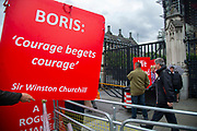 A man holds a sign referencing a famous Winston Churchill quote  Courage begrets courage outside  the Houses of Parliament on 9th September 2019 in London, United Kingdom. Prime Minister Boris Johnson is tabling another motion to seek a general election.