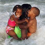 People enjoying the Beach near Johnie Mercer's Pier, Wrightsville, NC.