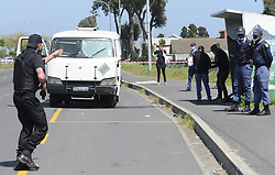 South Africa - Cape Town - 10 October 2020 - Police officers on the hunt for suspects following cash van robbery and shootout in Cash Transit, Attempted Cash Heist in Robert Sobukwe Road the  Road was closed in both directions, between Valhalla Drive and Borchards Quarry. A stolen vehicle was also discovered on the scene. Photogrpher Ayanda Ndamane/African News Agency(ANA)