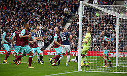 A header from West Bromwich Albion's Gareth Barry (centre, left) goes over the bar during the Premier League match at The Hawthorns, West Bromwich.