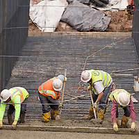 032213       Brian Leddy<br /> Workers from G. Sandoval Construction in Albuquerque smooth concrete at the First Street Bridge in Grants Friday. The project is one of several public works projects being worked on in Grants.