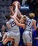 DePaul's Dee Bekelja, center, is caught between Connecticut's Kyla Irwin, left, Katie Lou Samuelson, right, and Connecticut's Olivia Nelson-Ododa, back, as they all reach for a rebound during the first half of an NCAA college basketball game in Hartford, Conn., Wednesday, Nov. 28, 2018. (AP Photo/Jessica Hill)