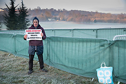 © Licensed to London News Pictures. 04/12/2019. Watford, UK. Lone protestor Stuart Holmes stands in an area designated for demonstrators near the gates to The Grove Hotel where NATO leaders are meeting. World leaders are attending a series of events over the two day NATO summit which will mark the 70th anniversary of the alliance of nations. Photo credit: Peter Macdiarmid/LNP